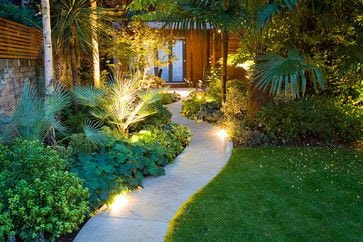 Path with lights and tropical plants