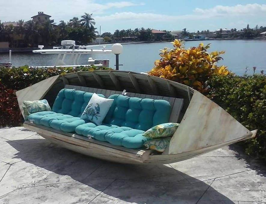 Old boat used as a garden seating area