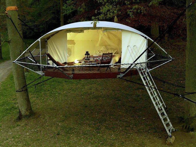 A floating treehouse, suspended between two trees
