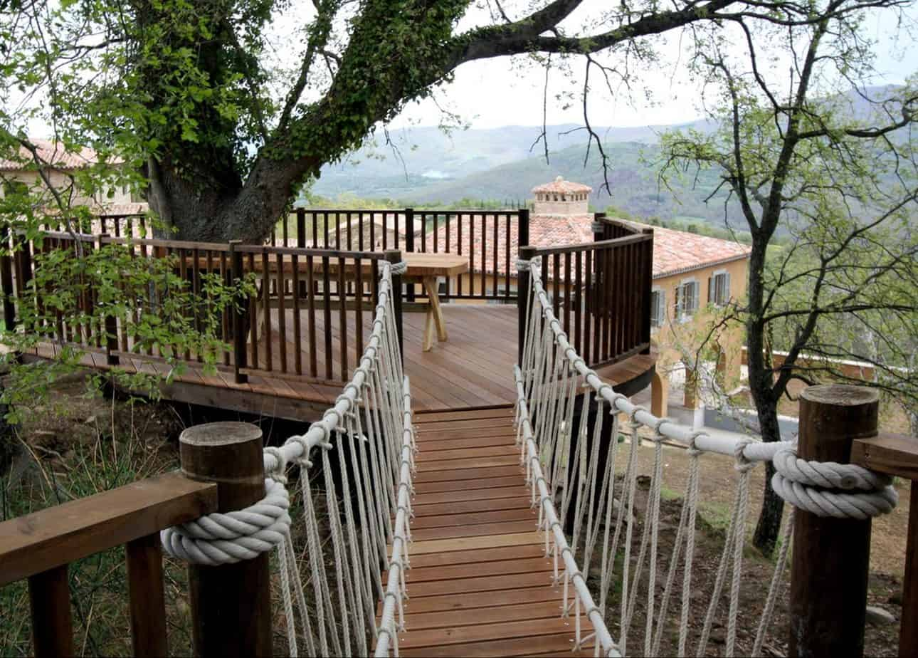 A simple tree deck with hanging bridge