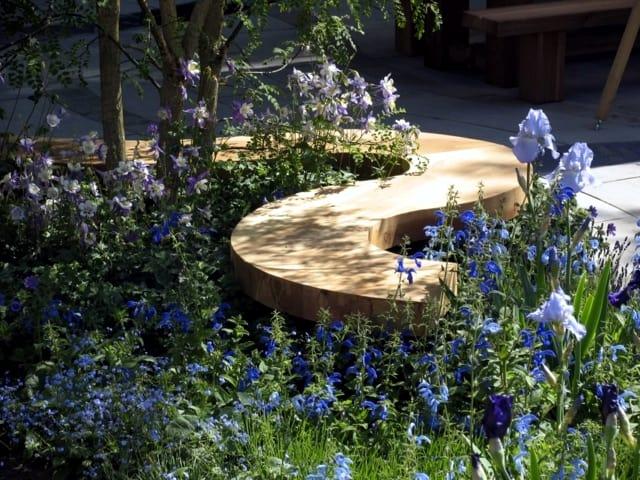 Spiral shaped wooden garden bench