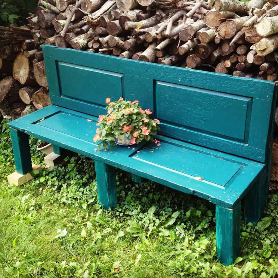 Blue garden bench made out of old doors