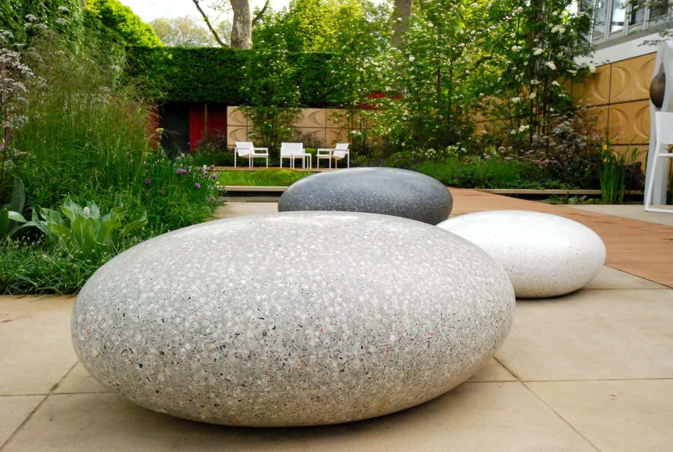 Stone pebble garden bench in oval shape