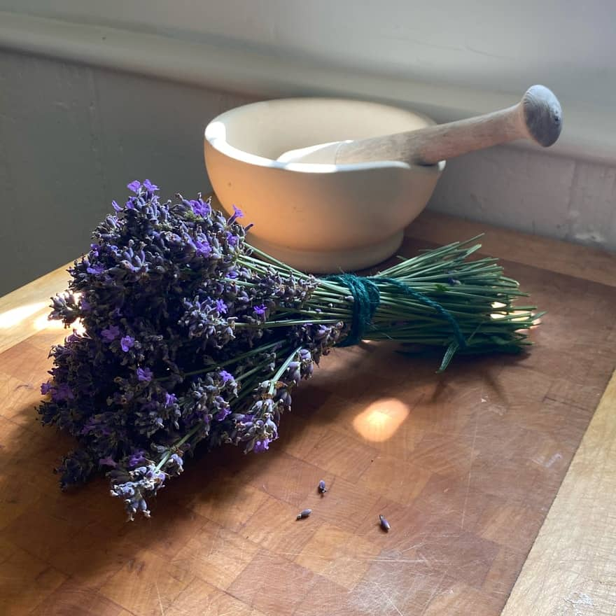 Small bouquet of lavender with porcelain mortar and pestle
