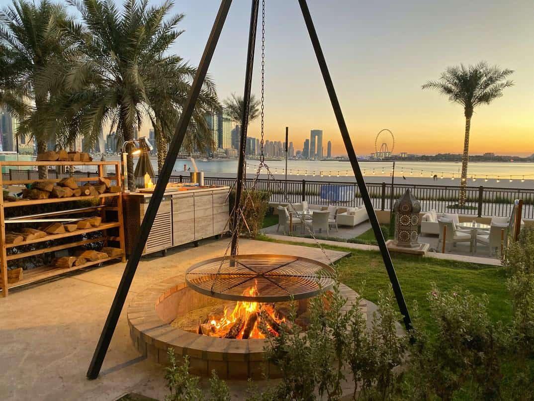 Fancy garden firepit with beautiful ocean background in Dubai