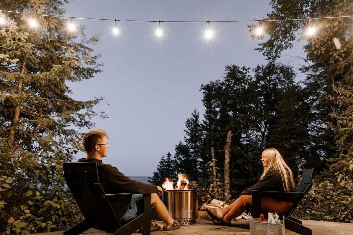 A couple cosying up around a DIY fire pit